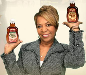 Michele Hoskins holding syrup