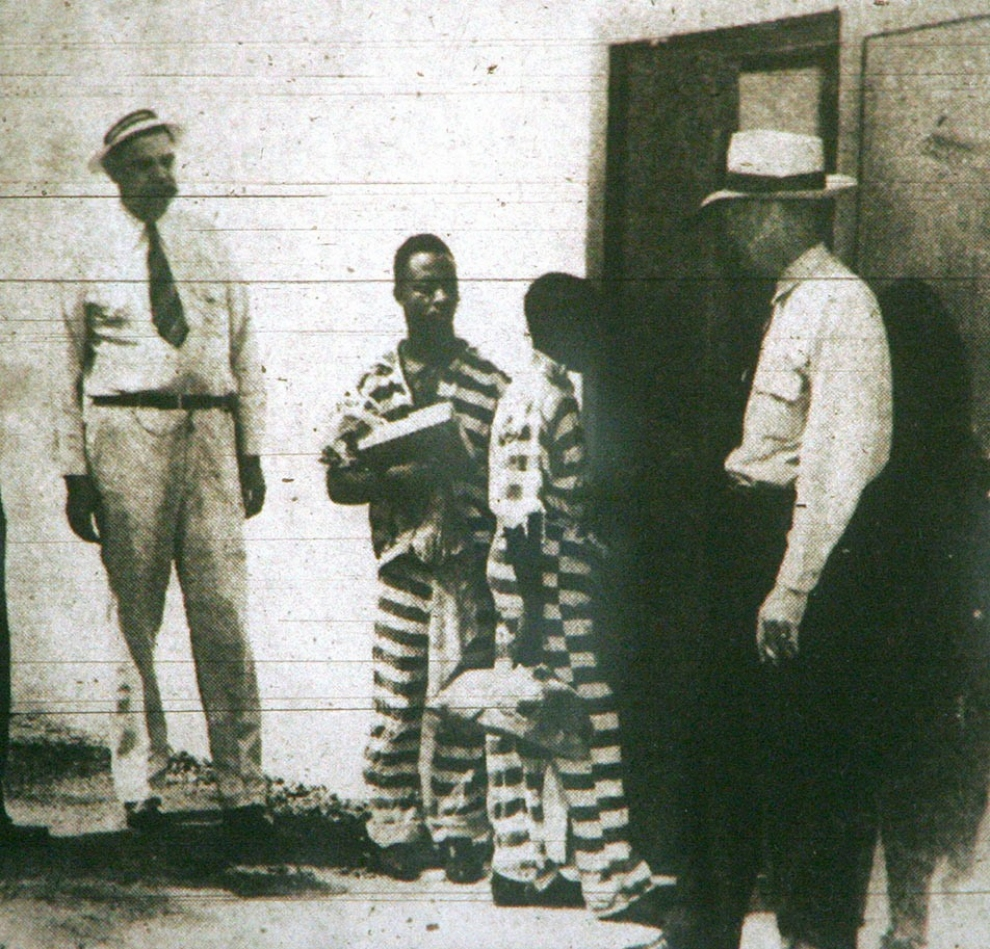 A copy of a photo that ran June 8, 1944, in The Columba (S.C.) Record, showing Stinney, center right, and Bruce Hamilton, 21, center left, enter the death house in the state prison. Both were executed June 16, 1944. Jimmy Price/The Columbia Record/AP