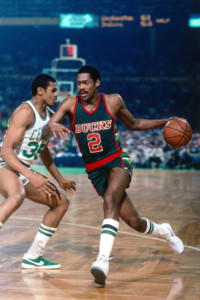 BOSTON - 1983: Junior Bridgeman #2 of the Milwaukee Bucks drives to the basket against Charles Bradley #35 of the Boston Celtics during a game played in 1983 at the Boston Garden in Boston, Massachusetts. NOTE TO USER: User expressly acknowledges and agrees that, by downloading and or using this photograph, User is consenting to the terms and conditions of the Getty Images License Agreement. Mandatory Copyright Notice: Copyright 1983 NBAE (Photo by Dick Raphael/NBAE via Getty Images)